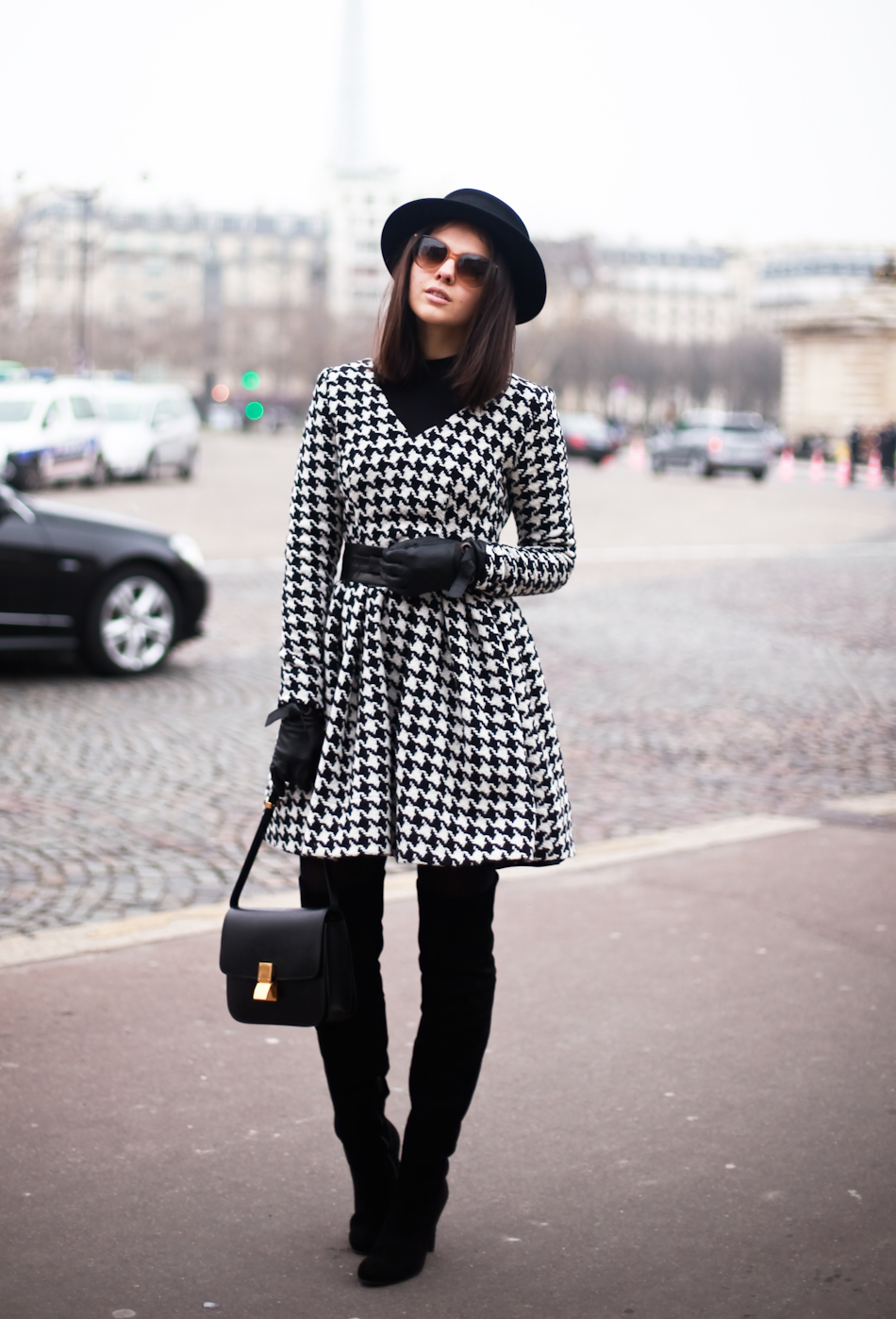 Doina Ciobanu in a houndstooth dress and belt designed by herself