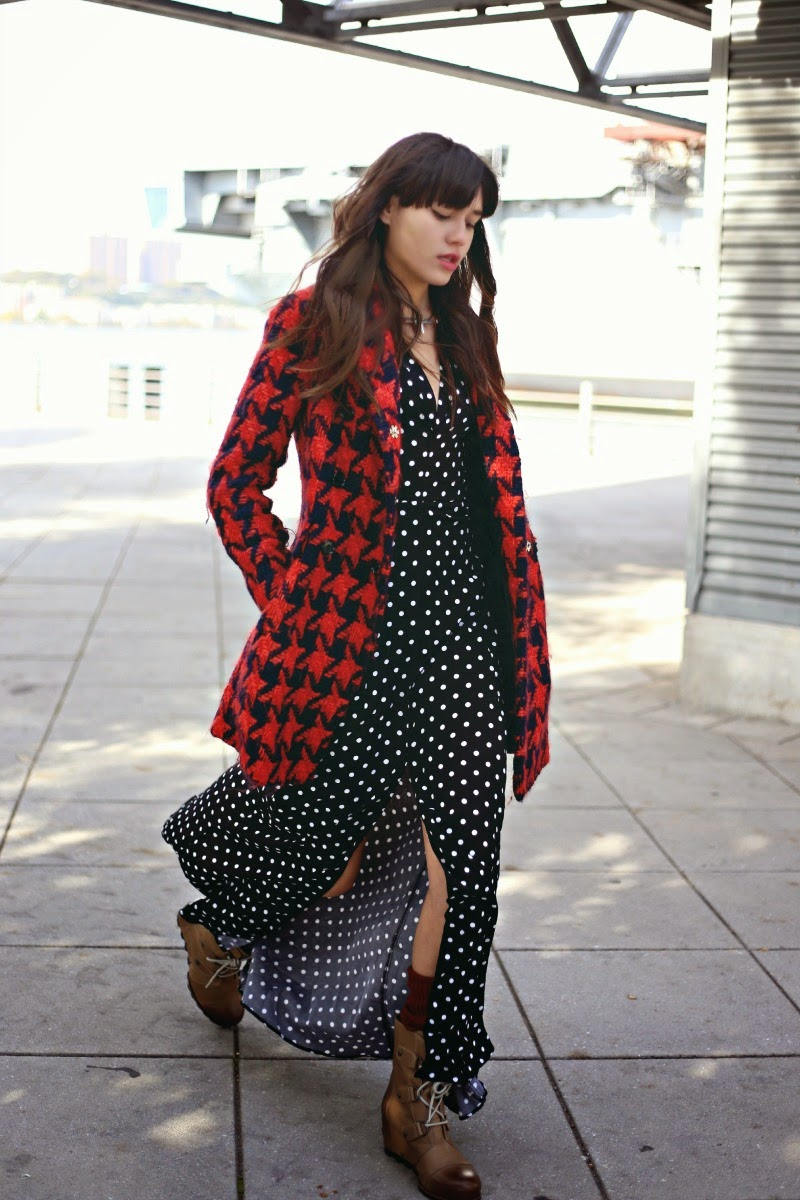 Houndstooth Fall 2014: Natalie Suarez is wearing a red and blue houndstooth coat from Miu Miu