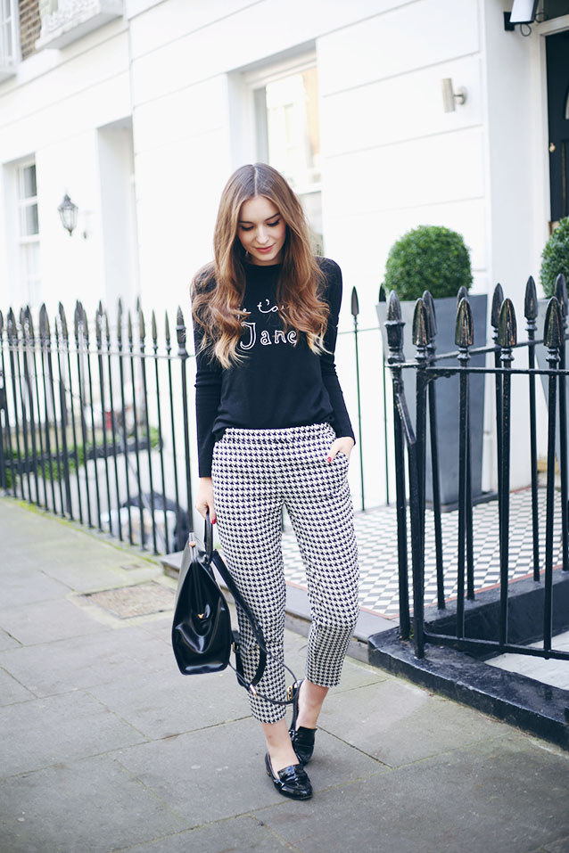 Olivia Purvis in houndstooth print trousers from TopShop