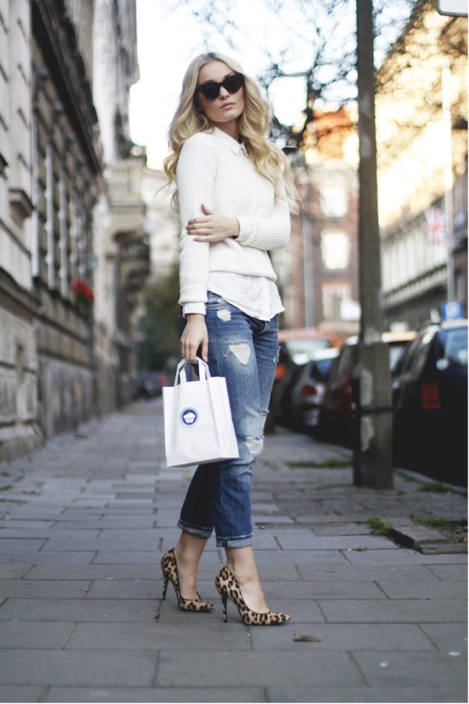 Marie Wolla is wearing a ripped jeans from Monki, white knit top from Zara, shirt from Vila, leopard print shoes from Steve Madden adn the sunglasses are from Celine