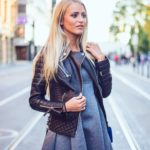Janni Deler is wearing a black leather jacket from Boda Skins, grey dress from Chicwish and the bag is from Chanel