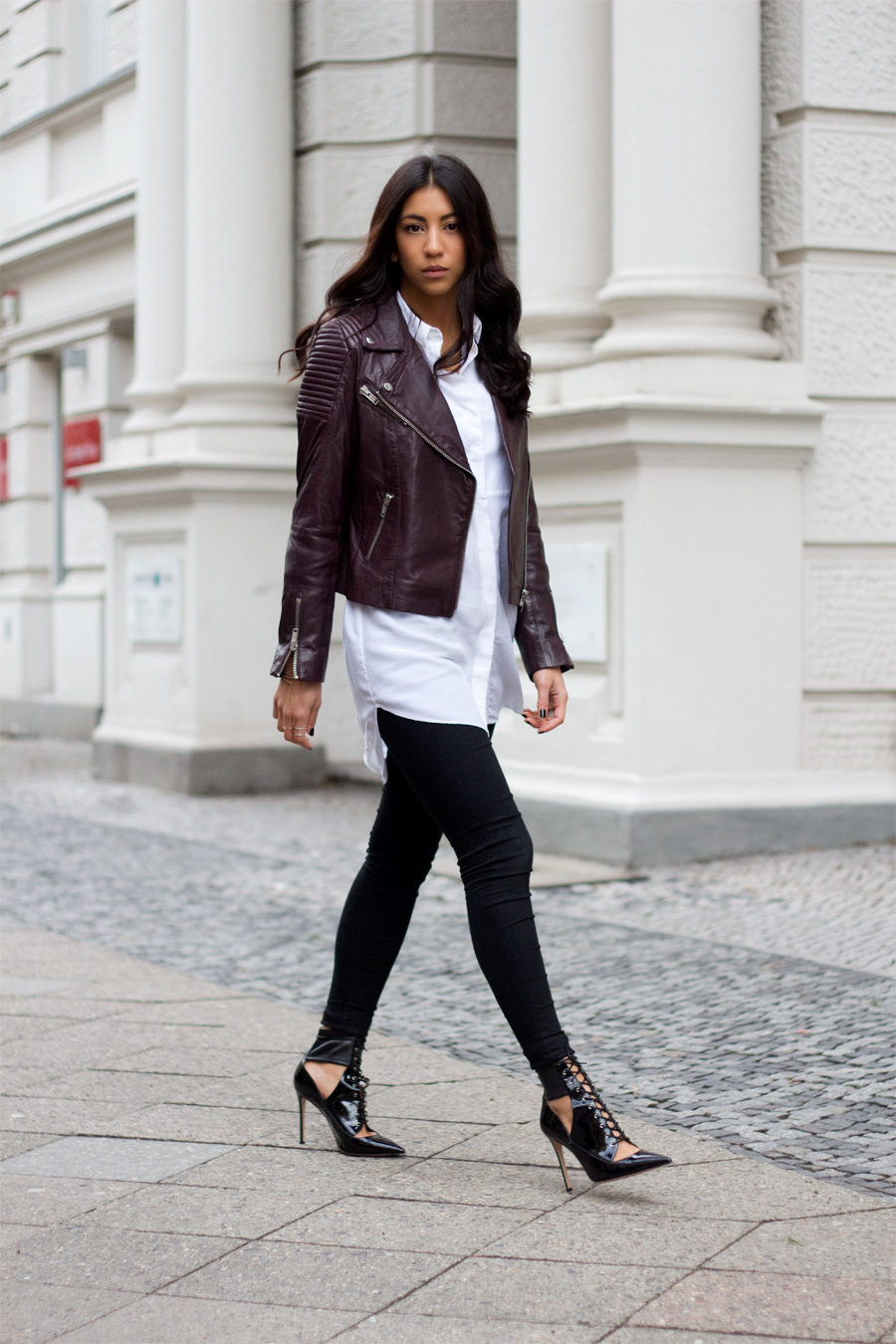 Kayla Seah is wearing a burgundy leather jacket from Edited