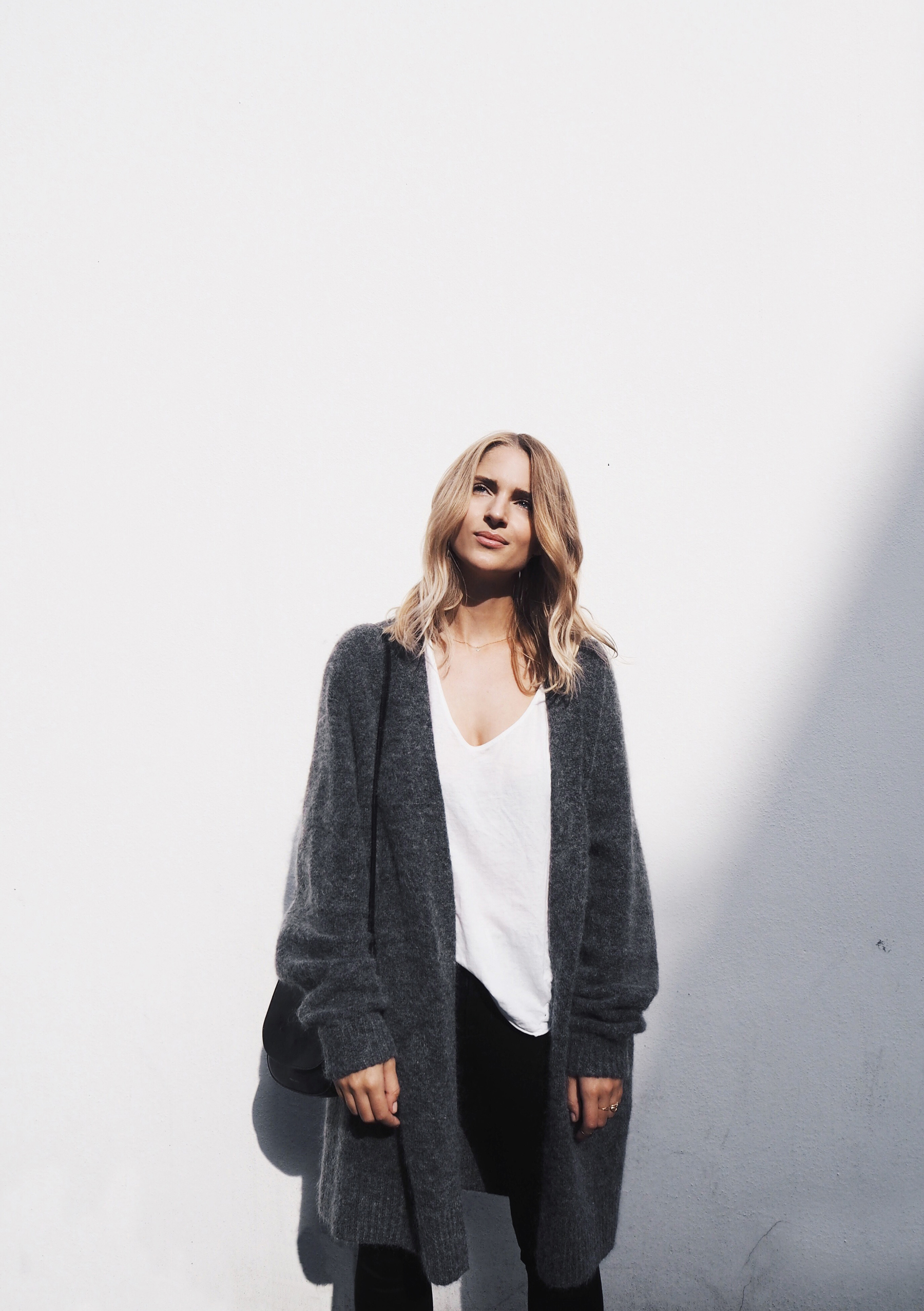 This long marl grey cardigan goes perfectly with a simple white top and black jeans combo. Via Mijaflatau.com. Cardigan: ACNE Studios, White Tee: Bassike.