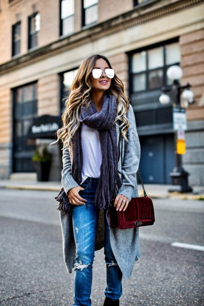 Long cardigans have never been more in style! Maria Vizuete wears this classic cashmere cardi with distressed denim jeans and a plain white tee for a laid back, casual style. Throw on an oversized scarf to recreate this fabulous look.   Scarf: Free People, Cardigan: Nordstrom, Bag: Rebecca Minkoff.