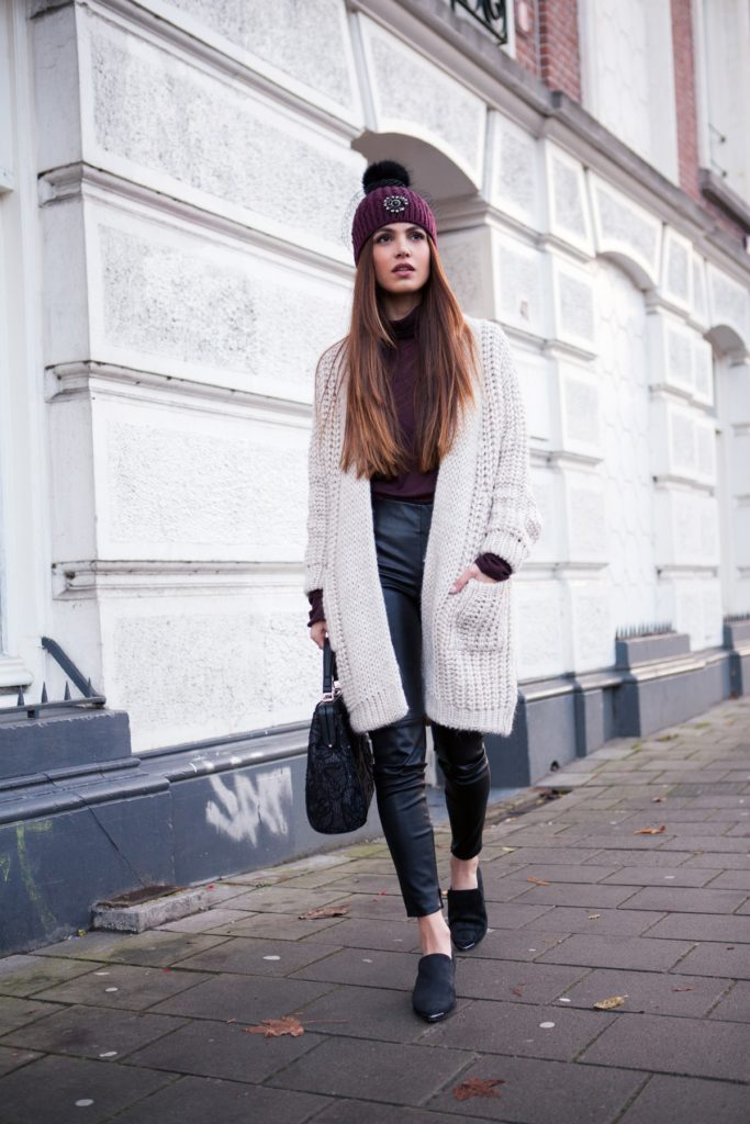 Negin Mirsalehi is wearing a sand coloured long knit cardigan with pockets from Zara