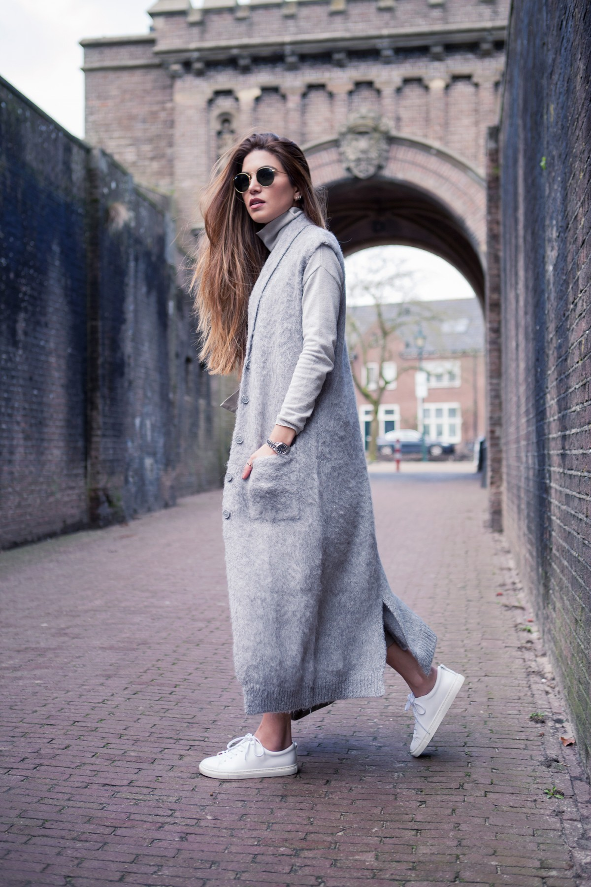 How To Style A Long Cardigan: Negin Mirsalehi is wearing a long sleeveless cardigan from Asos