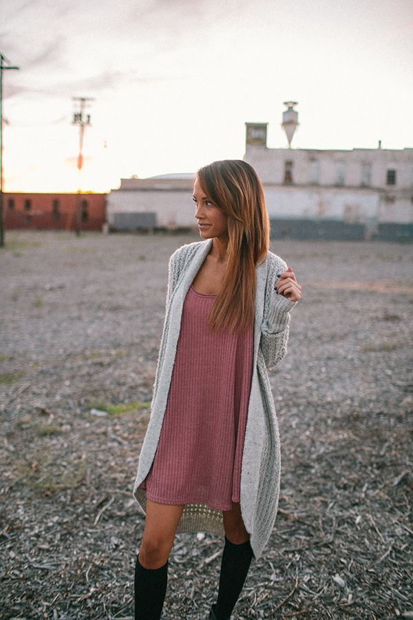 Megan Anderson in a long grey cardigan outfit from Urban Outfitters