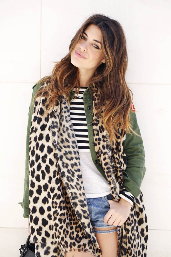 Aida Domenech is wearing a khaki jacket with patches from Forever21