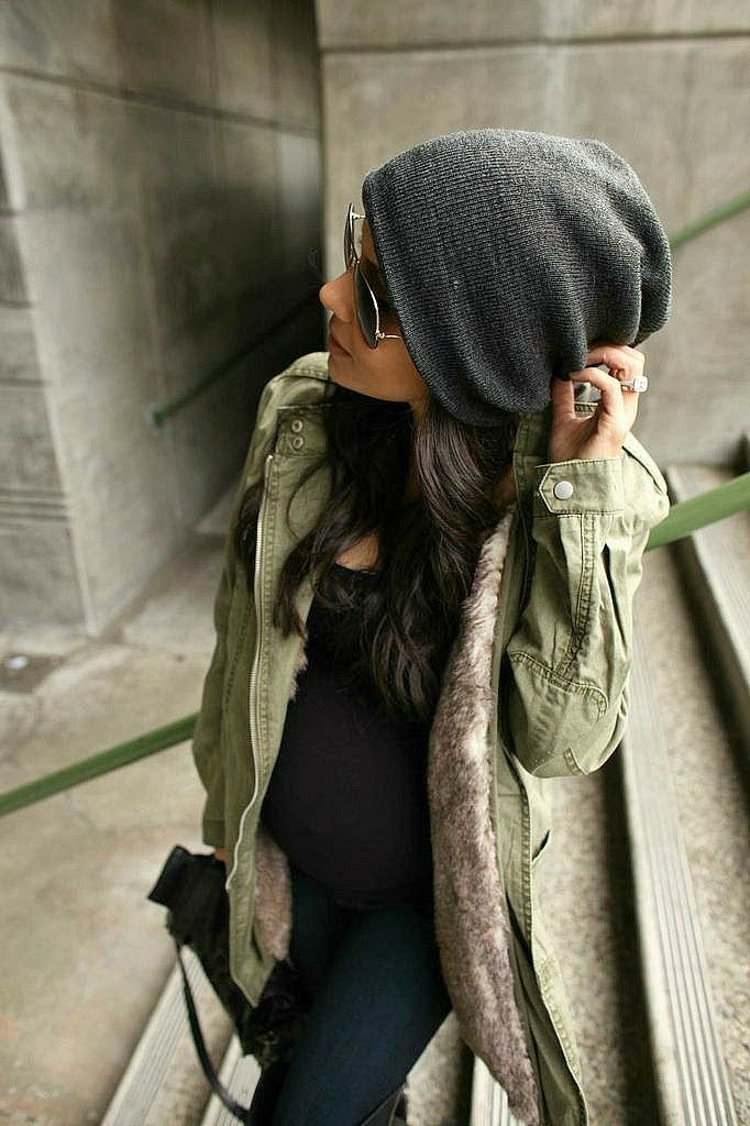 Andee Layne is wearing a khaki faux fur lined parka from Mango