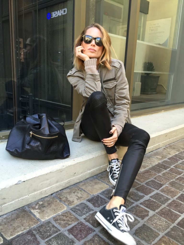 Anine Bing is wearing a khaki army jacket from Anine Bing
