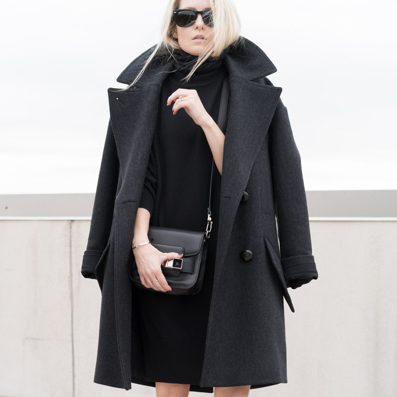 Figtny is wearing an oversized charcoal coat from Isabel Marant by way of H&M