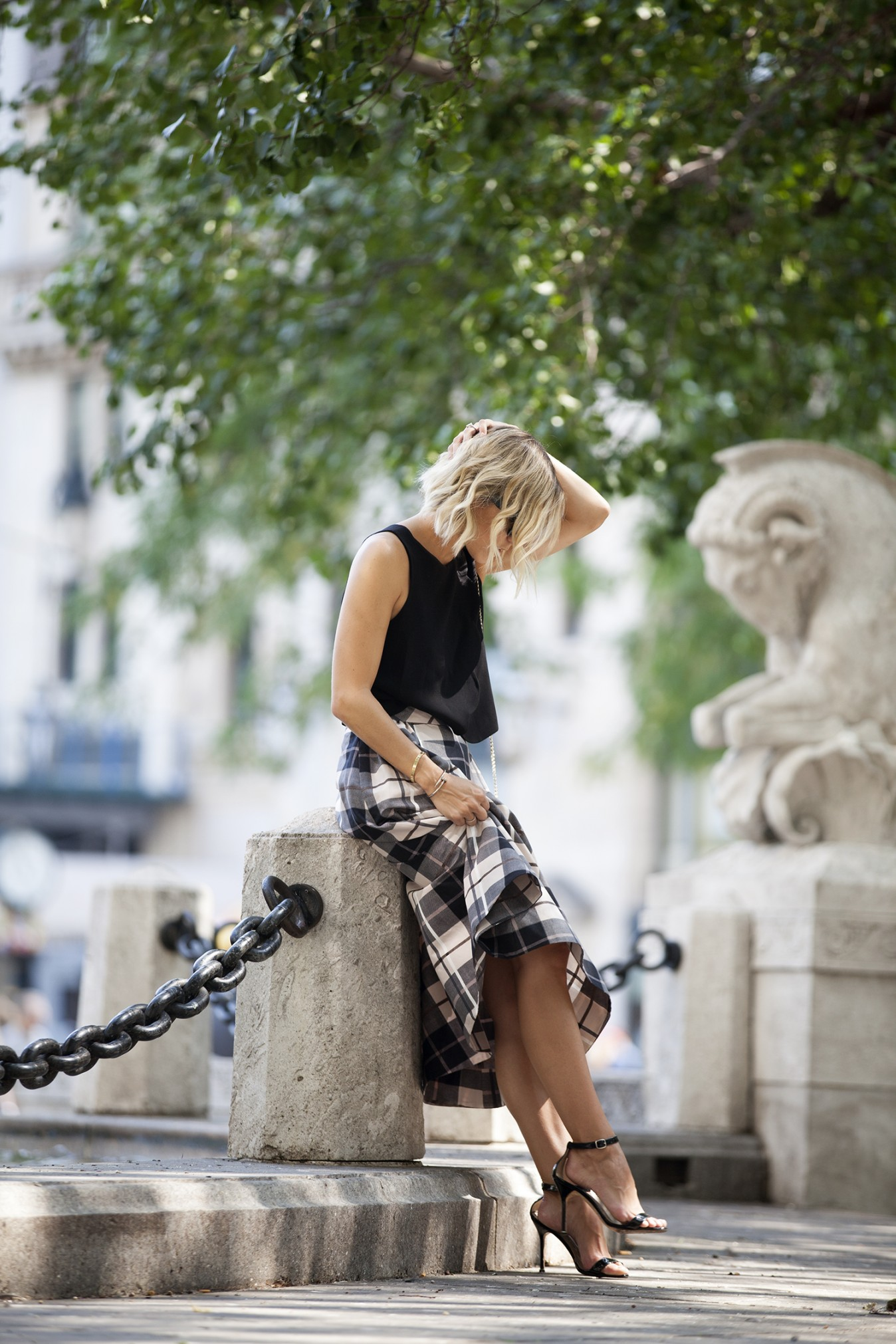 Jacey Duprie wears gorgeous plaid midi skirt with plain black vest top and heels. Skirt: Kate Spade, Top: Club Monaco.