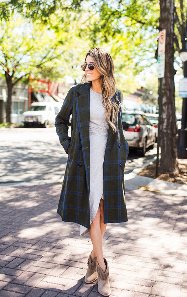 Christine Andrew rocks the plaid trend in a long trench coat and fringed leather ankle boots.  Coat/Dress: ILY Couture.