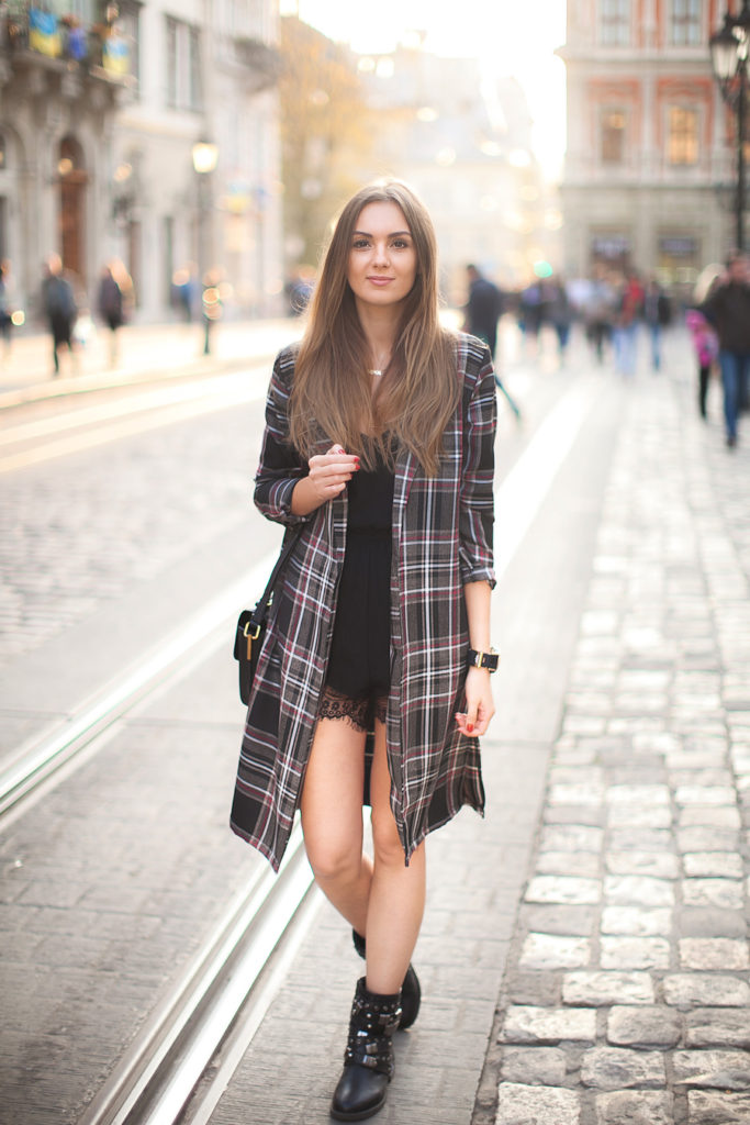 Plaid Fashion: Nika Huk is wearing a plaid coat from Love