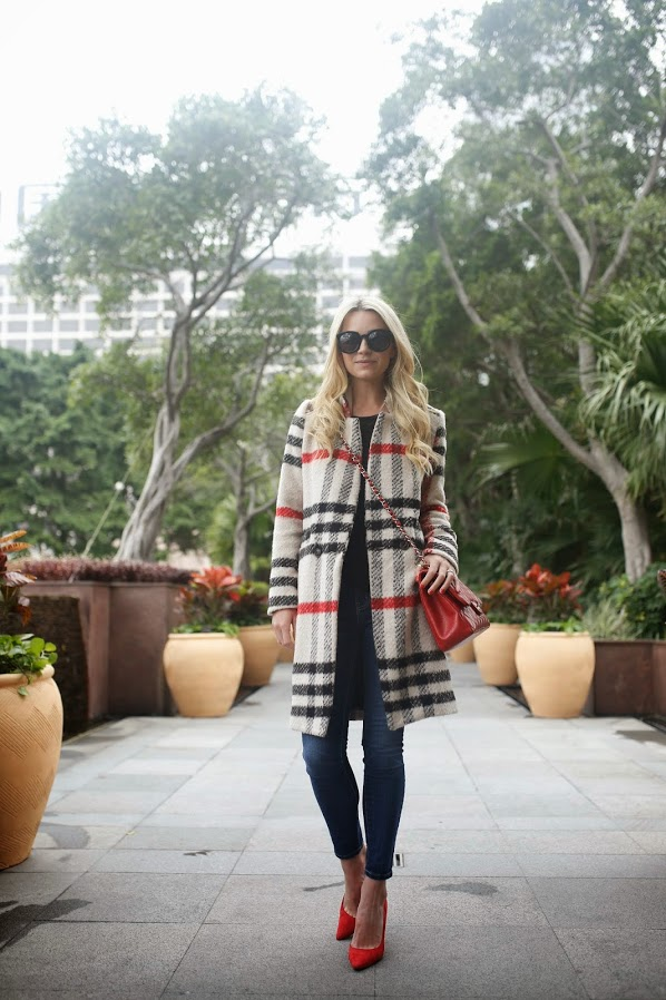 Blair Eadie is wearing a red and black plaid coat from Storets