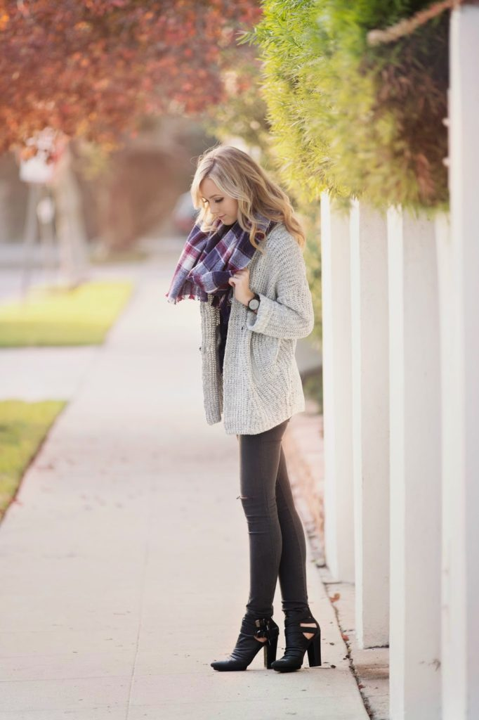 Sheridan Nicole Gregory is wearing a plaid blanket scarf from Madewell
