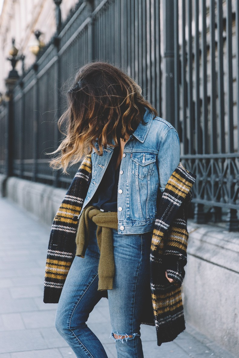 Sara Escudero is wearing a black, yellow and white plaid coat from Zara