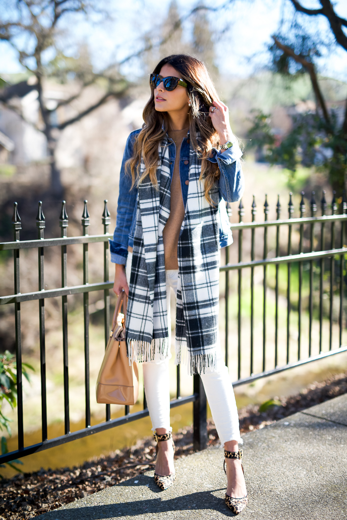 Pam Hetlinger is wearing a grey and white cozy plaid scarf from Gap