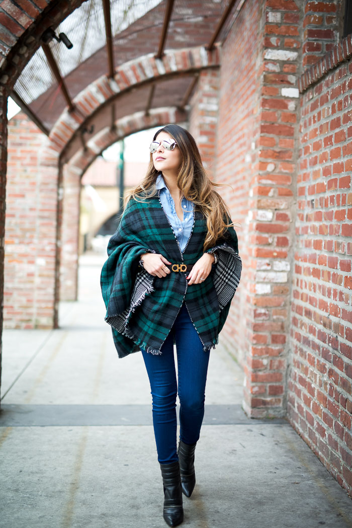 Pam Hetlinger is wearing a green and blue plaid blanket scarf from Shenside