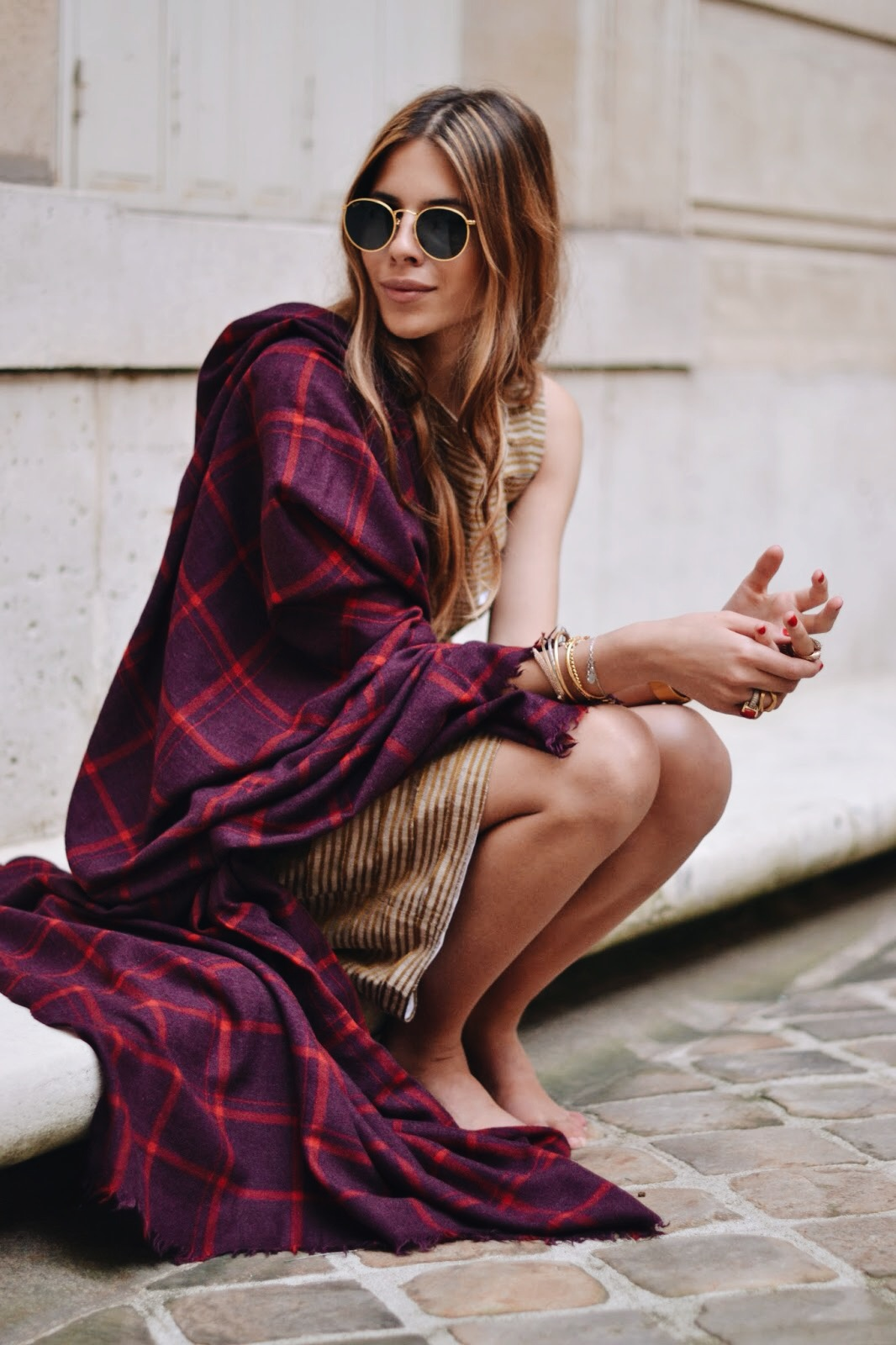 Maja Wyh is wearing a shirt and skirt from Odeeh, and the plaid scarf is from Comptoir des Cotonniers