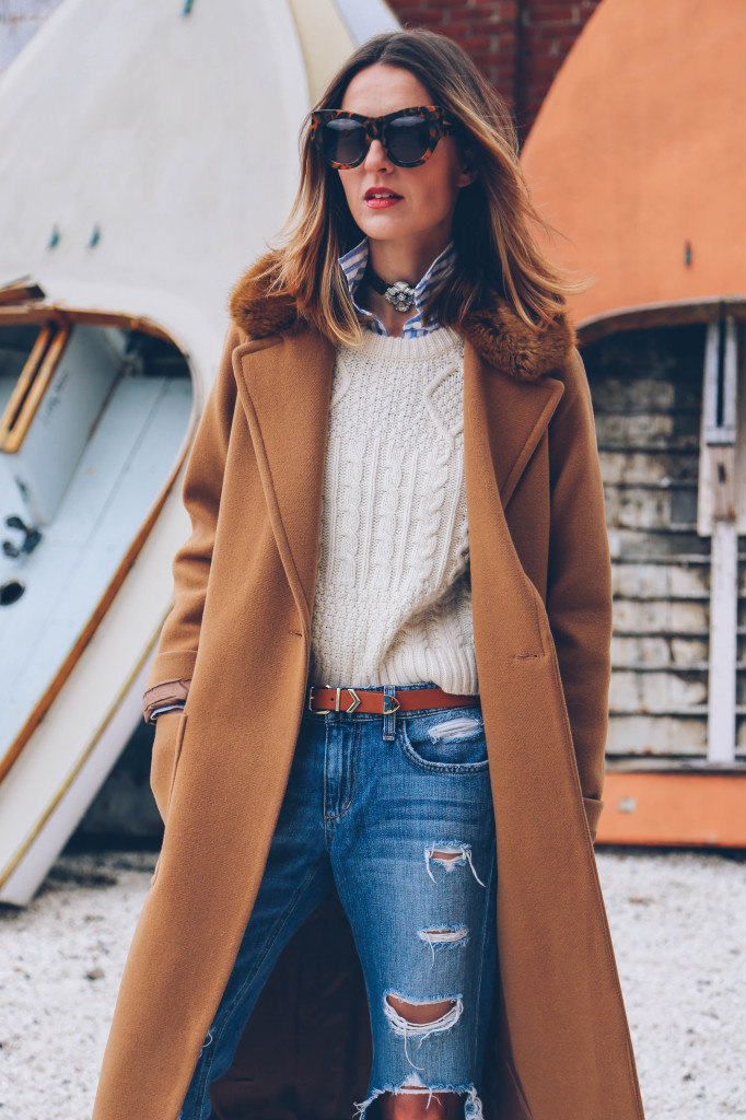 Preppy Outfit: Jess Ann Kirby is wearing a striped shirt from J Crew, white cable knit sweater from TopShop, ripped jeans from Joe's Jeans and the camel coat is from French Connection