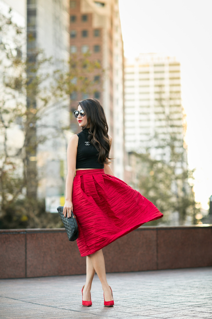 Wendy Nguyen in her red skirt and crop top