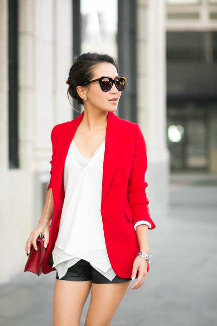 Wendy Nguyen is wearing a red blazer from Joseph