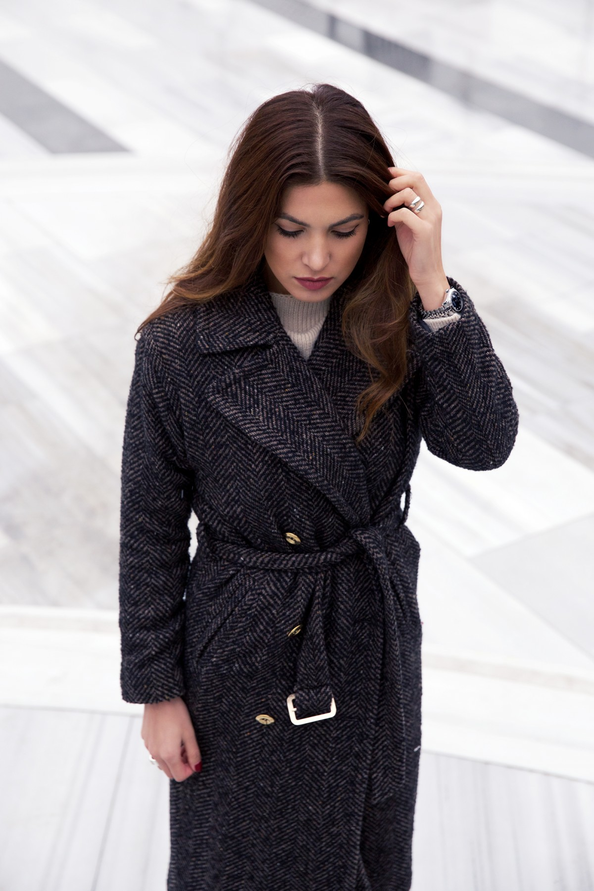 Negin Mirsalehi is wearing a dark grey herringbone robe coat from River Island