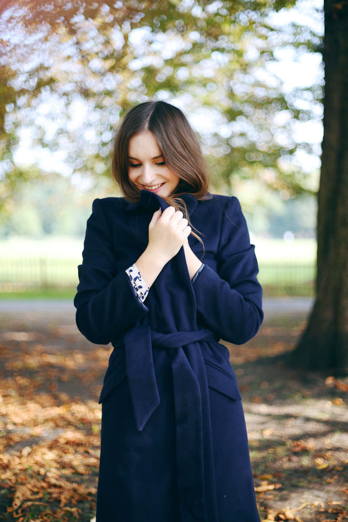 Olivia Purvis is wearing a dark blue Claudia robe coat from Boden