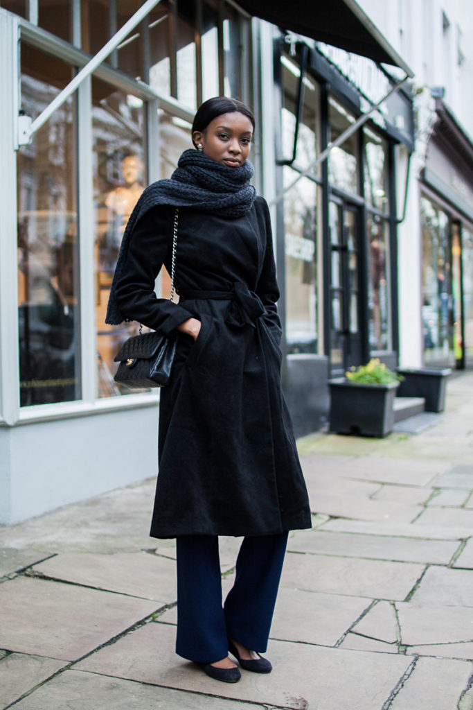 Natasha Ndlovu is wearing a black wool blend robe coat from Chicwish
