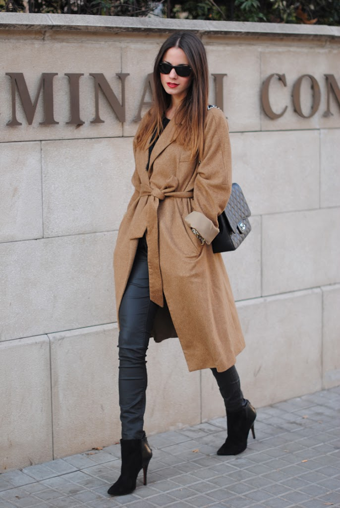 Robe Coat Outfit: Zina Charkoplia is wearing a robe coat from Zara