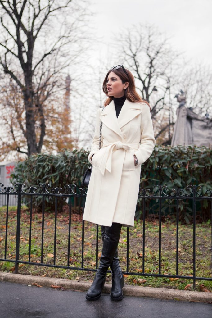 Belted Coat Trend: Negin Mirsalehi is wearing a cream belted coat from Envy