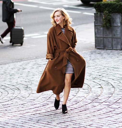 Sarah Mikaela is wearing a brown robe coat from Alexon