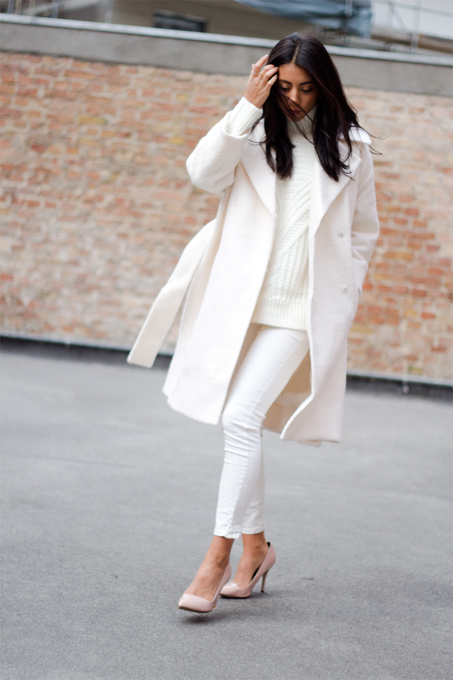 Belted Coat Trend: Kayla Seah is wearing all white, the belted coat is from ASOS
