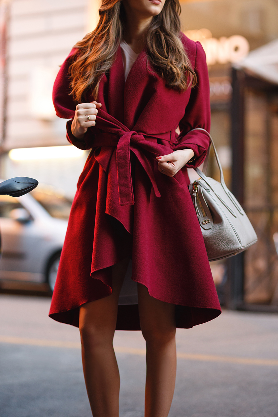The robe coat trend looks best worn in bold colours. This deep red number looks wintery and festive - so we love it. Via Larisa Costea. Coat: Chic Diva.