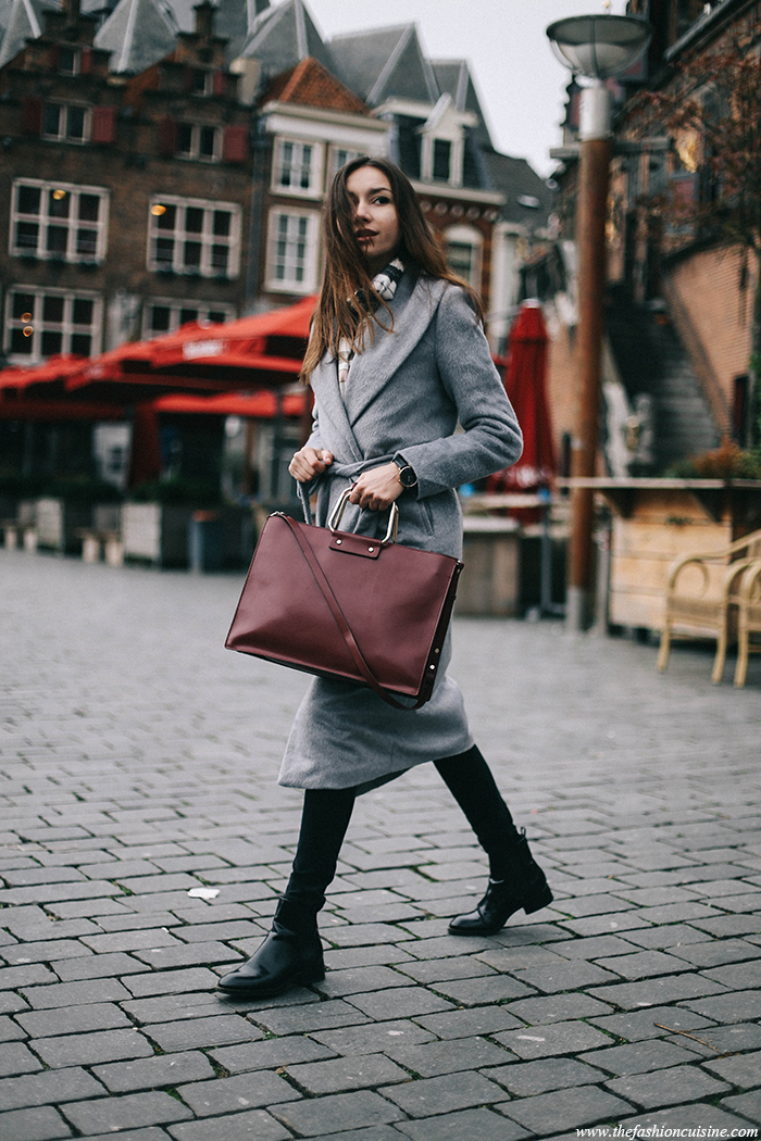 A grey robe coat like this one will look great for either a smart or casual look. Beatrice Gutu pairs the coat with super skinny jeans and a sleek burgundy satchel. Coat: Missguided, Jeans: Asos, Boots/Bag: Zara.
