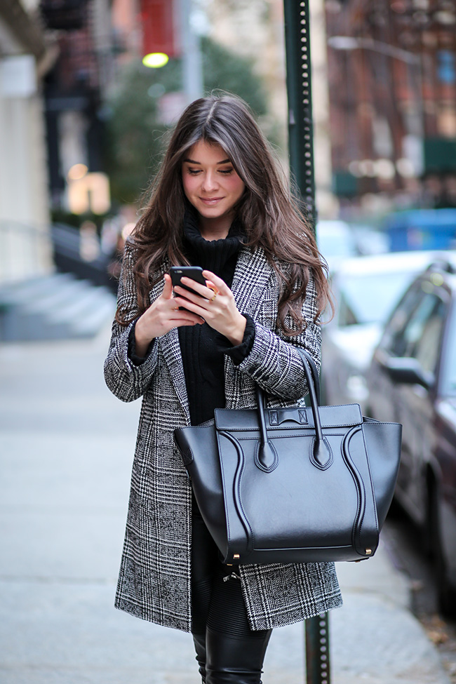 Liv Micheli is wearing a black and white plaid coat fromTopshop, black turtleneck from Joypeace, trousers from and the handbag is from Céline