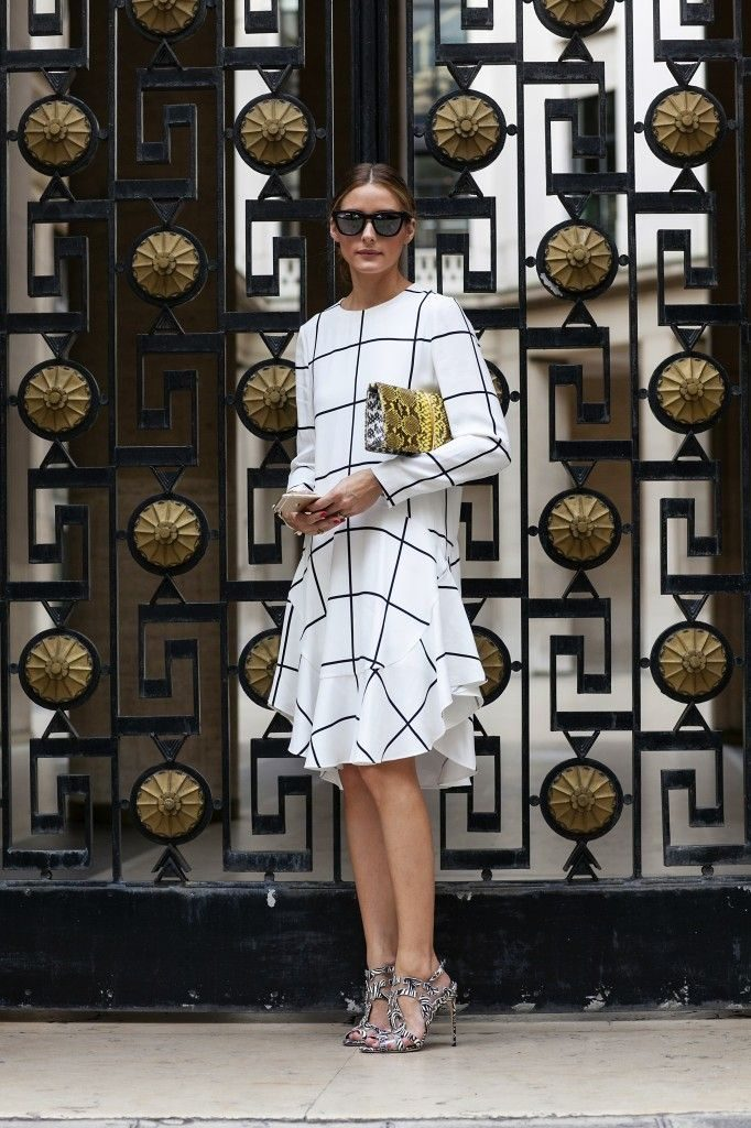 Olivia Palermo is wearing a grid print dress from Chloe, gold patterned bag from Nina Ricci, shoes from Brain Atwood and sunglasses from Westward Leaning