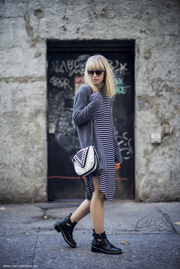 Autumn Street Style: Lisa Dengler is wearing a striped long sleeve dress from The Fifth Label, grey cardigan from Jaggar and the leather ankle boots are from Maje