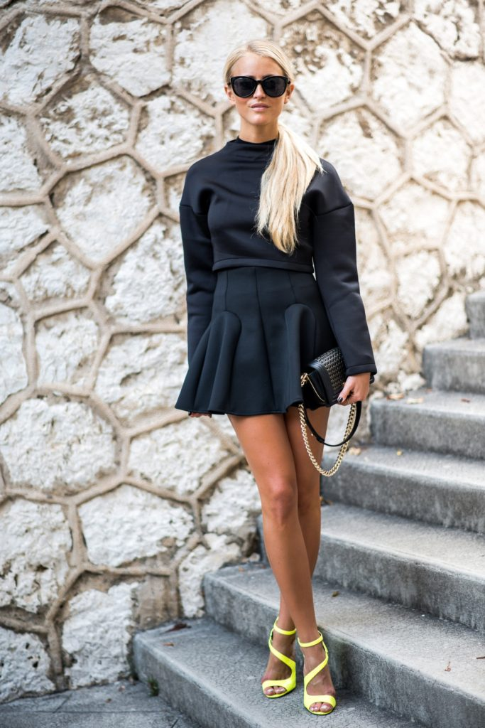 Janni Deler is wearing all black, legacy top from Bubbleroom, structured skirt from H&M, bag from Chanel and the shoes are from River Island
