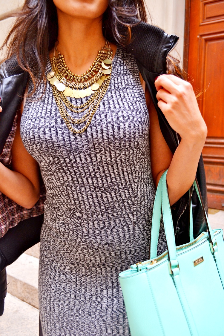 Sheena Virmani is wearing a grey bodycon midi dress from Dynamite and a layered chain coin necklace from Forever 21