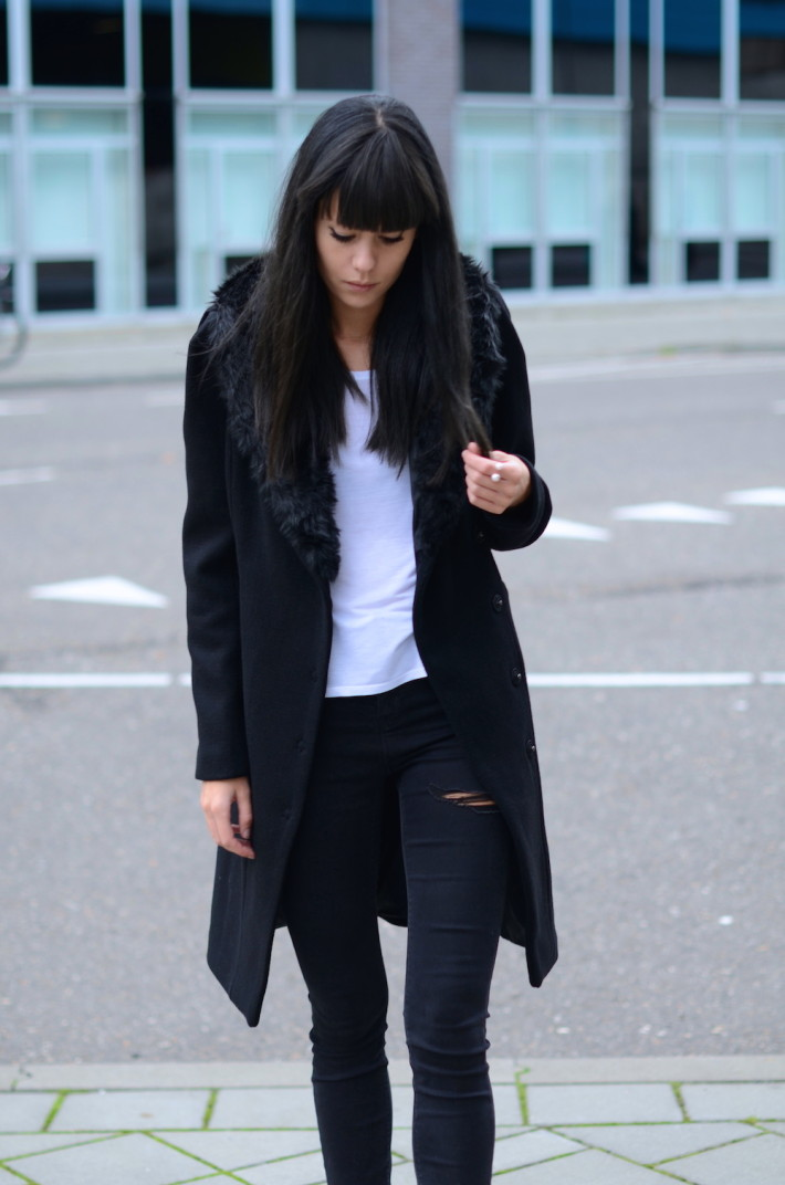 Lovely by Lucy is wearing a black faux fur trim coat from Mexx