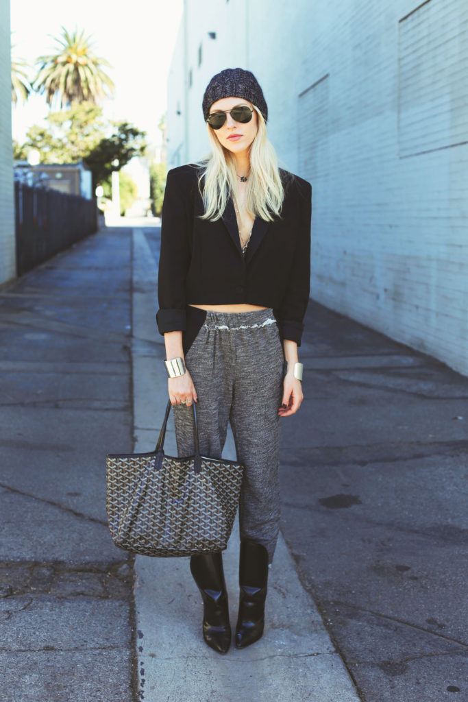 October: Shea Marie is wearing a trousers from Elie Tahari, black blazer from Barbara Bui, shoes from Alexander Wang, beanie from Eugenia Kim and the bag is from Goyard