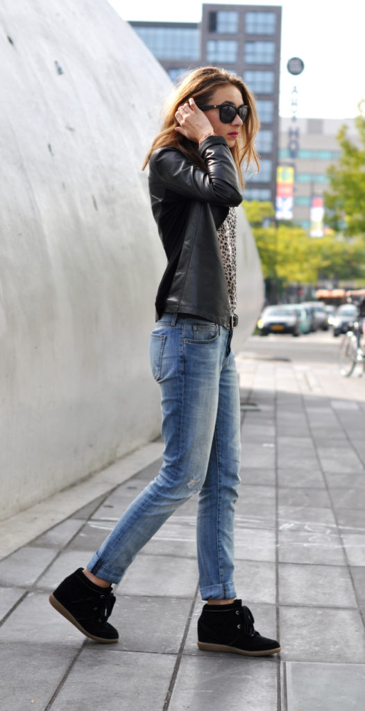 Kelly Elise is wearing a black leather jacket from Armani, leopard print top from Ba&sh, jeans from Current Elliot and the shoes are from Isabel Marant