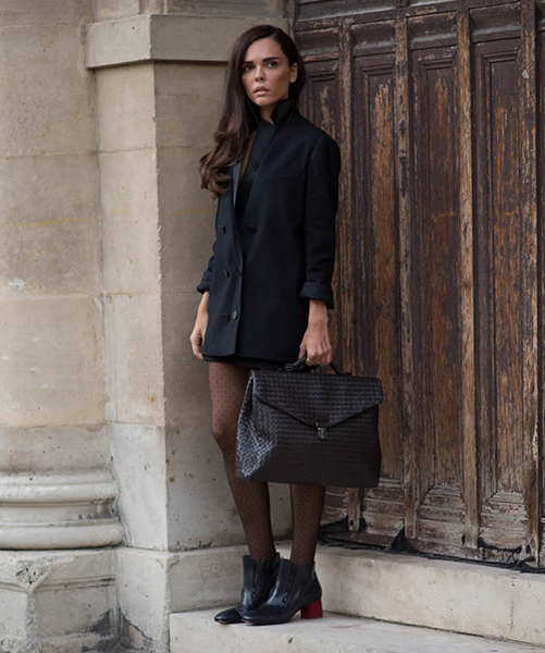 Evangelie Smyrniotaki is wearing black skirt and blazer from Lanvin, boots from Celine and the dark blue bag is from Bottega Veneta