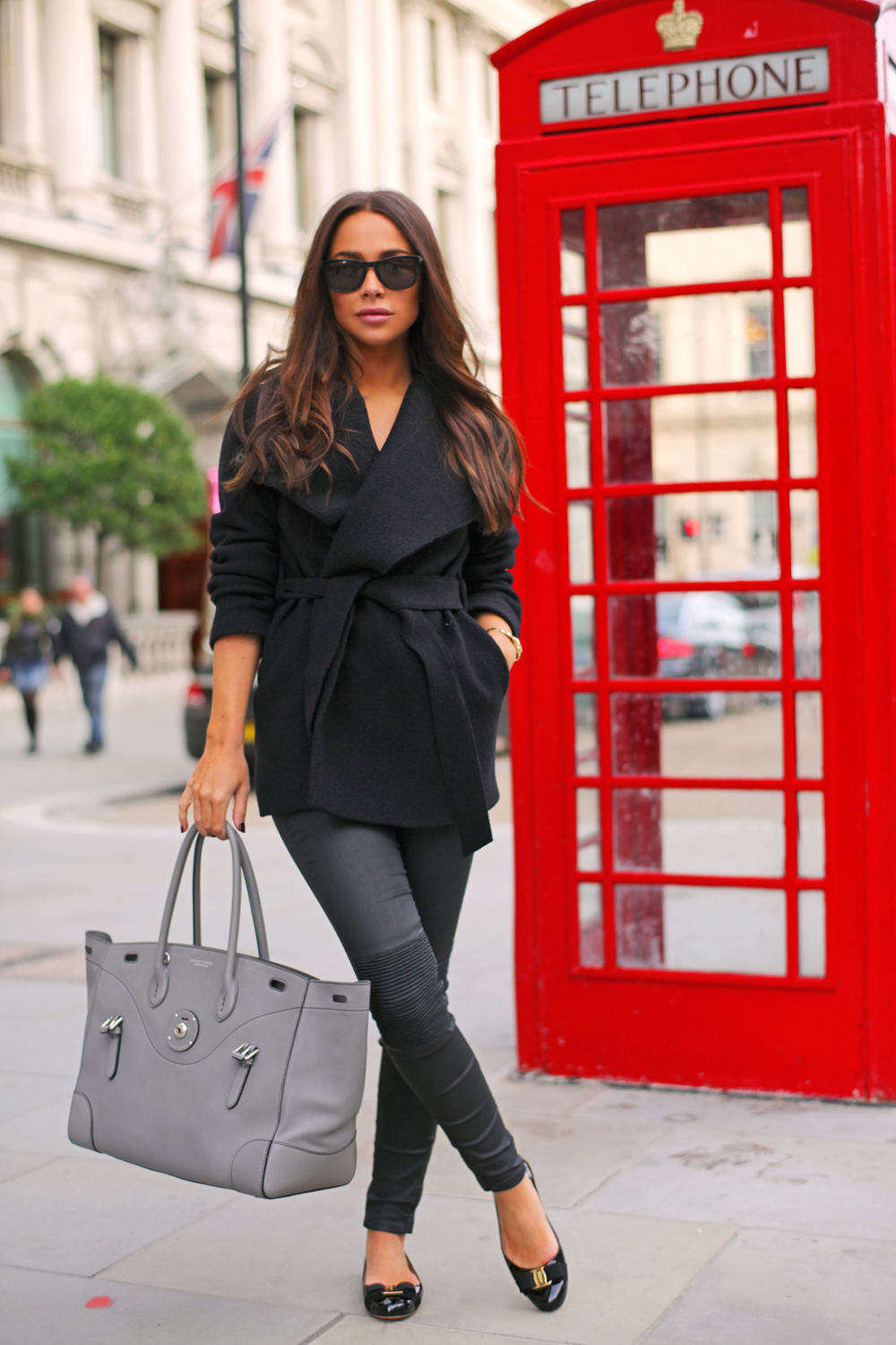Johanna Olsson is wearing a black flat shoes from Salvatore Ferragamo, trousers from Zara, black coat from Filippa K, sunglasses from Givenchy and the bag is Ralph Lauren