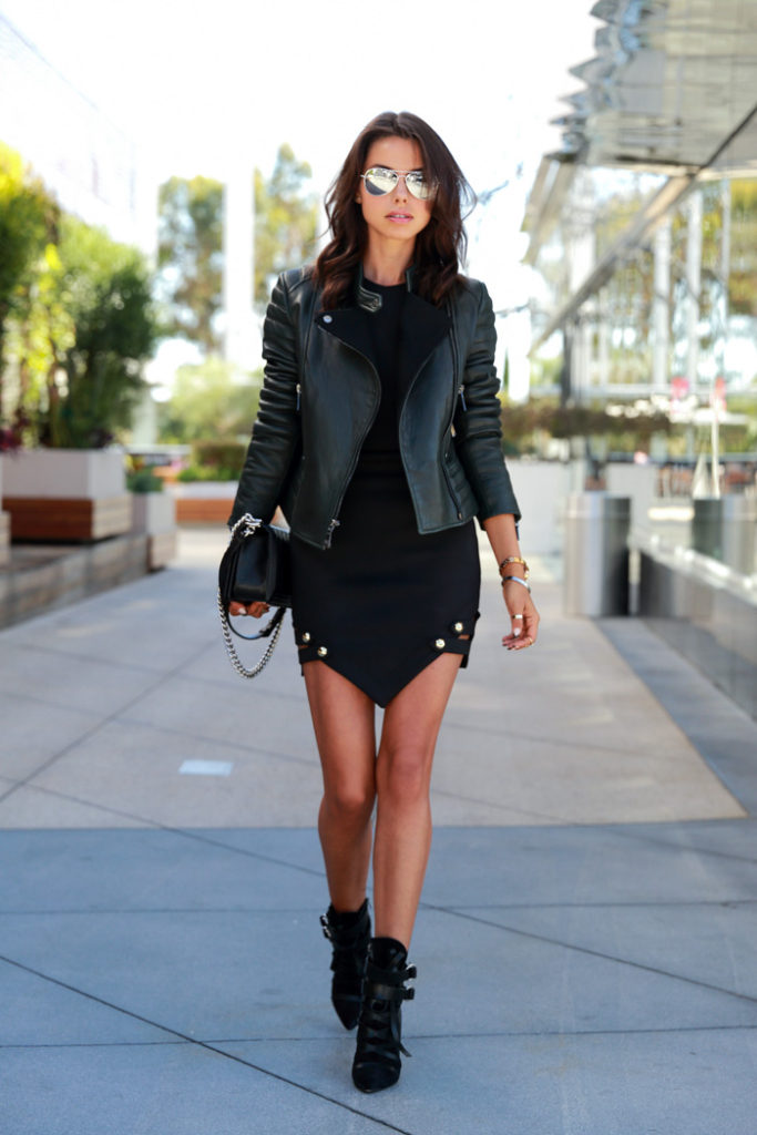 Annabelle Fleur is wearing all black, leather jacket from Dawn Levy Kristine, dress from Asilio On the Edge, ankle boots from Isabel Marant and the bag is from Chanel