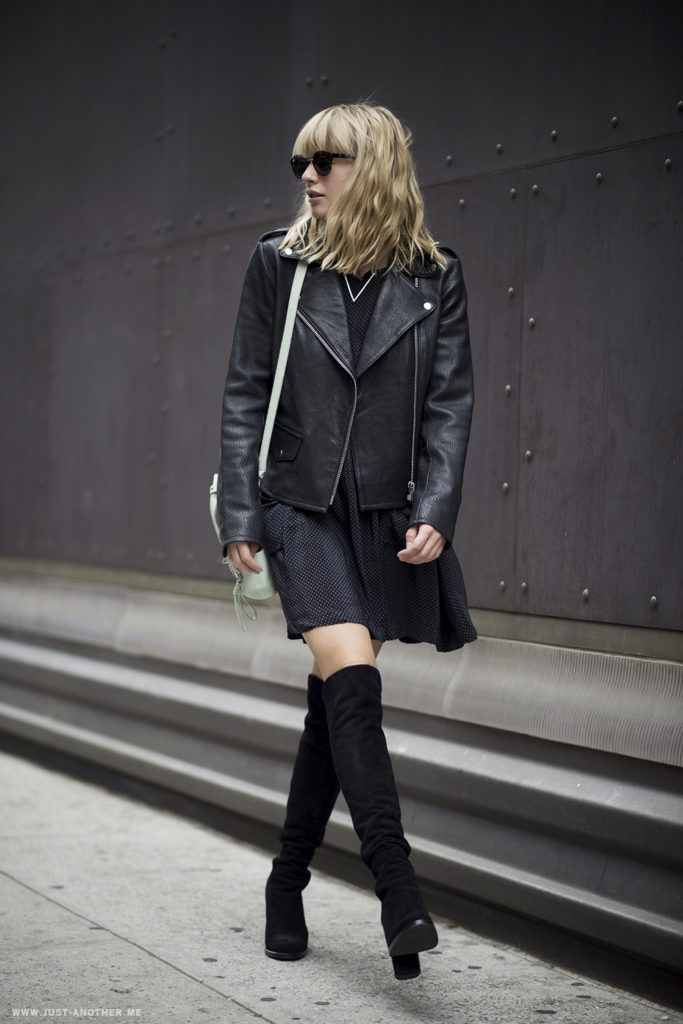 Lisa Dengler is wearing a thigh high boots from Stuart Weitzman, polka dot dress from Otte, leather jacket from Armani Exhange and the bag is from 3.1 Philip Lim