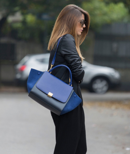 Nicoletta Reggio is wearing a black varsity jacket frm Zara, trousers from Balenciaga and the bag is from Celine