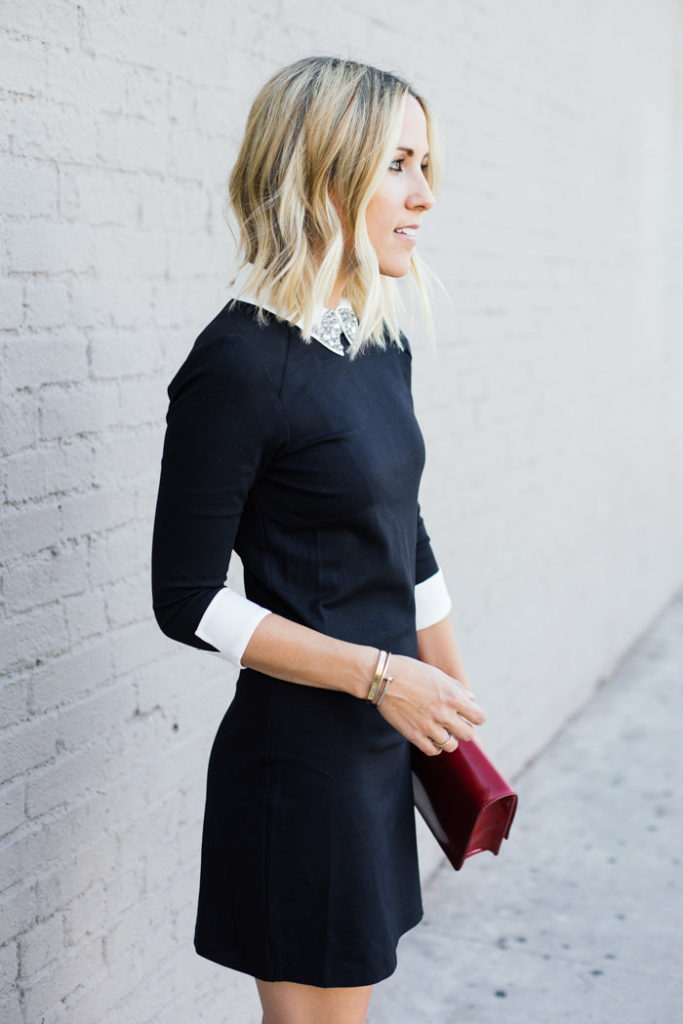 Jacey Duprie is wearing an embellished white collar dress from Ted Baker and the clutch is from Omni Park